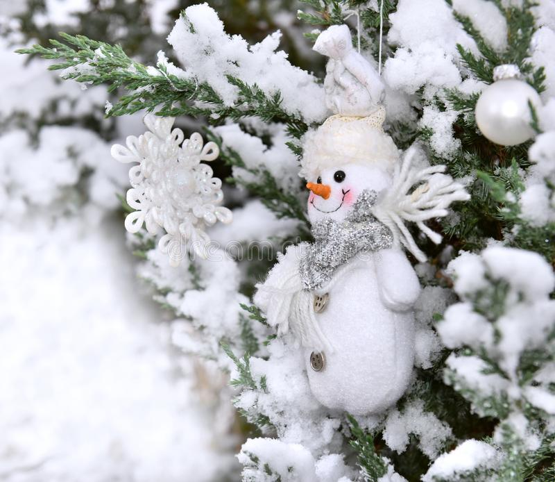 Christmas decoration tree snowcovered. Christmas tree snowcovered closeup snowflake snowman decoration stock photo
