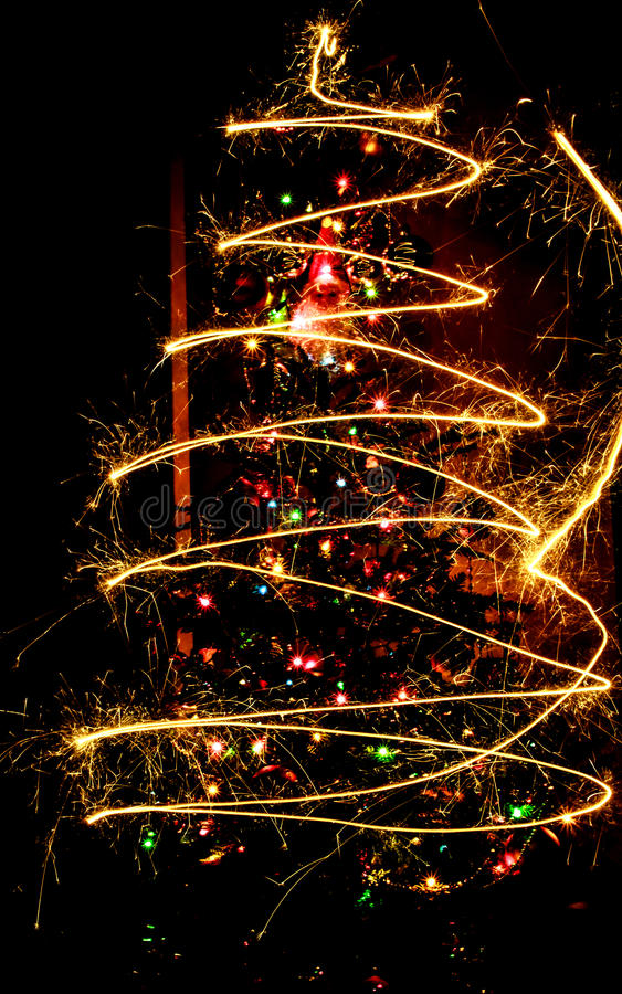 Christmas tree and sparklers royalty free stock photography