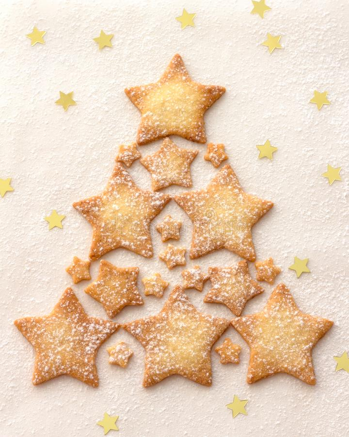 Christmas tree of a star cookie sprinkled with powdered sugar royalty free stock image