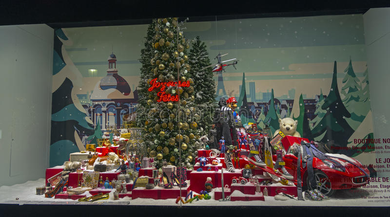 Christmas Tree Surrounded By A Variety Of Goods In A Shop Window ...