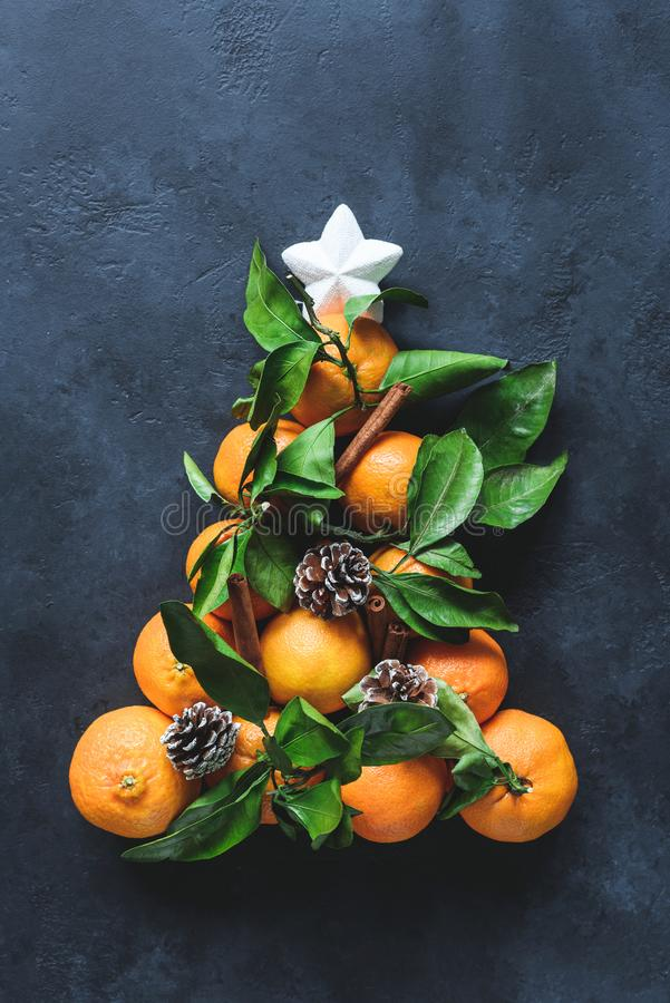 Christmas tree with tangerines, spices and pine cones decorated with white star. royalty free stock photography