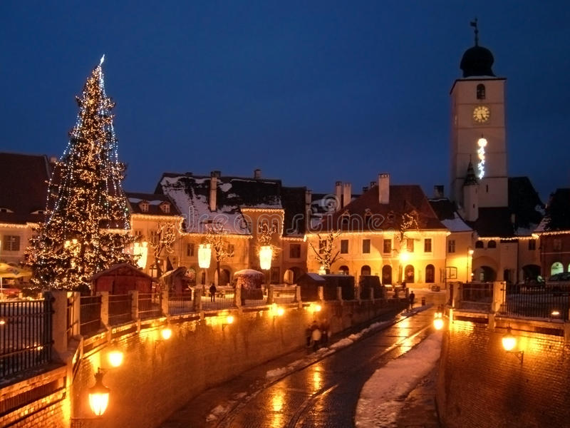 Christmas tree town street houses tower royalty free stock image