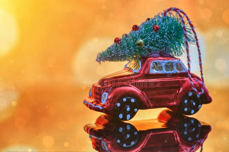 Christmas tree on toy car. Christmas holiday celebration concept royalty free stock photo