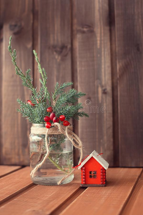 Christmas tree toy house on a wooden background royalty free stock photo