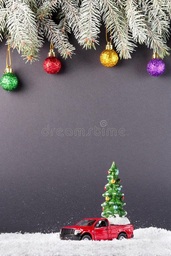 Christmas tree on toy Red Truck car on snow, balls christmas tree branches. Christmas holiday celebration concept royalty free stock photos