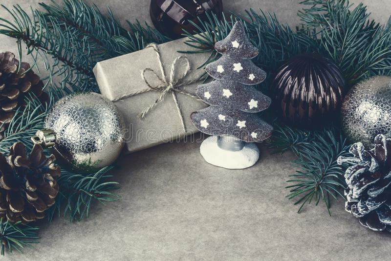 Christmas tree toys, cones and pine branches on craft paper, stylized as a vintage greeting card royalty free stock photography