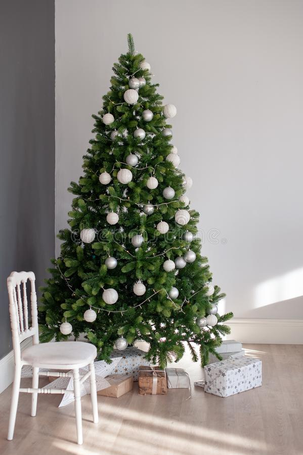 Christmas tree with white decorations royalty free stock photo