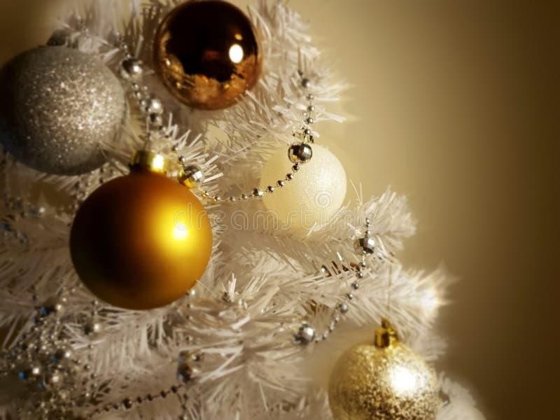 White Christmas decoration tree, gold ,silver, ,white balls silver garland,christmas light,decoration ,illumination ideas royalty free stock image