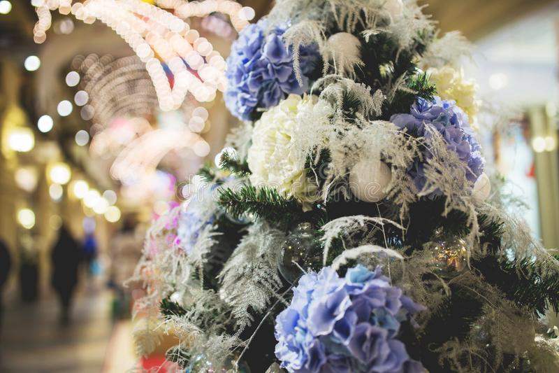 Christmas tree with white-purple flowers stock images