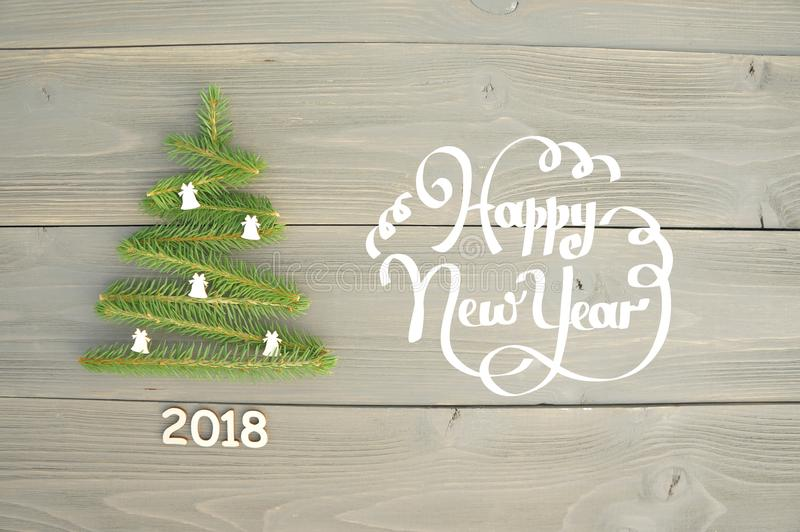 Christmas tree on wooden background. Happy new year. royalty free stock photos