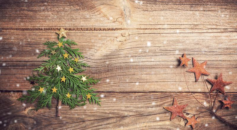 Christmas tree on wooden board with many stars royalty free stock image