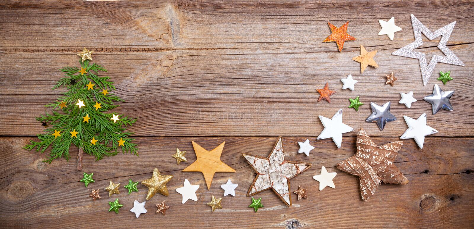 Christmas tree on wooden board with many stars royalty free stock photo
