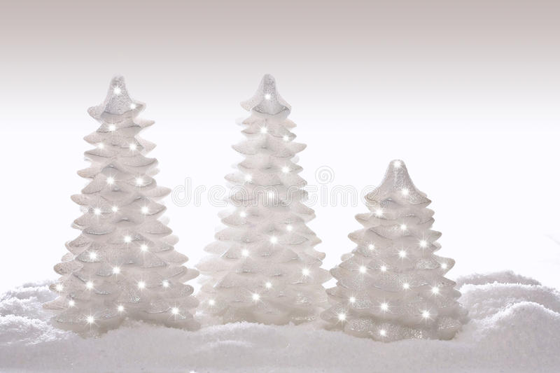 Christmas trees. Sparkly glitter Christmas trees in silver and white royalty free stock image