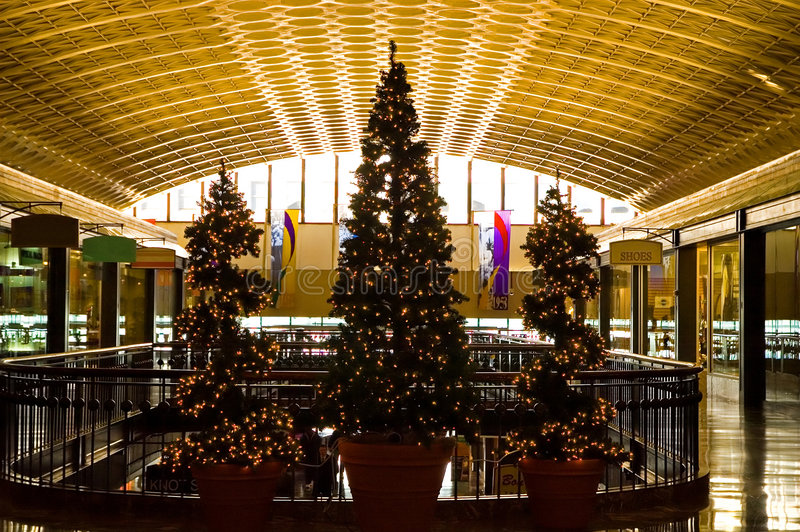 Christmas Trees in Shopping Mall. Three lighted Christmas trees on the top level of a large shopping mall stock image
