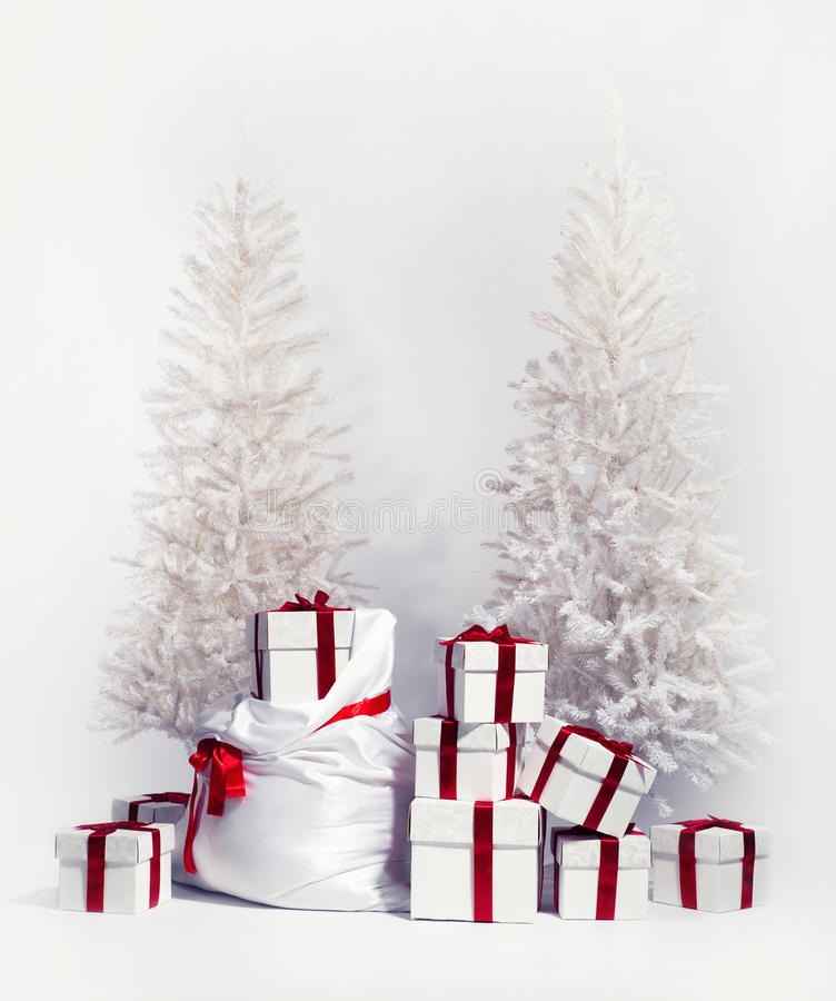 Free Christmas Trees With Heap Of Gift Boxes Stock Photos - 21930593