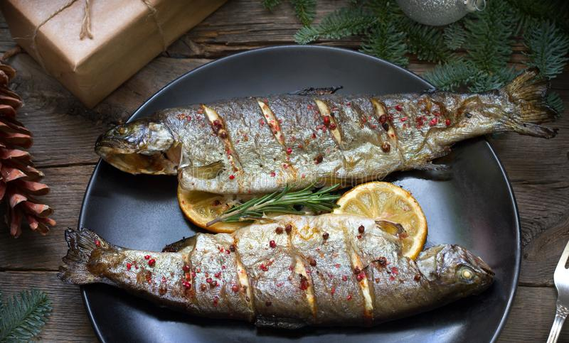 Christmas trout baked fish on table with ornament. Closeup stock photo