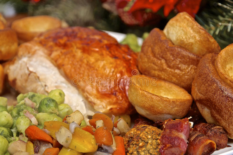 Christmas Turkey Dinner. On a serving plate a Christmas roast Turkey dinner with all the trimmings of brussel sprouts, roast potatoes, yorkshire pudding, carrots royalty free stock photography