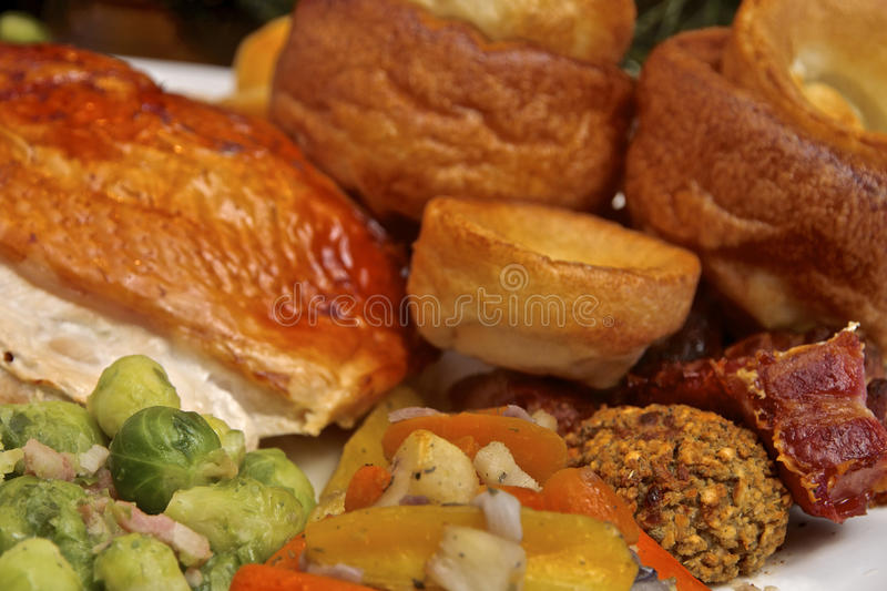 Christmas Turkey Dinner. On a serving plate a Christmas roast Turkey dinner with all the trimmings of brussel sprouts, roast potatoes, yorkshire pudding, carrots royalty free stock images