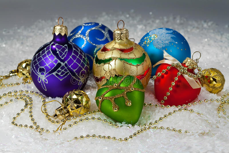 Christmas vibrant decorations on snow stock image