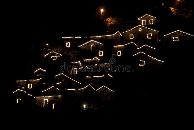 Christmas village. A little mountain village illuminated for Christmas time in the night