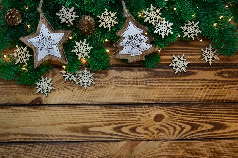 Christmas vintage decoration with fir branch on dark wooden background stock photography