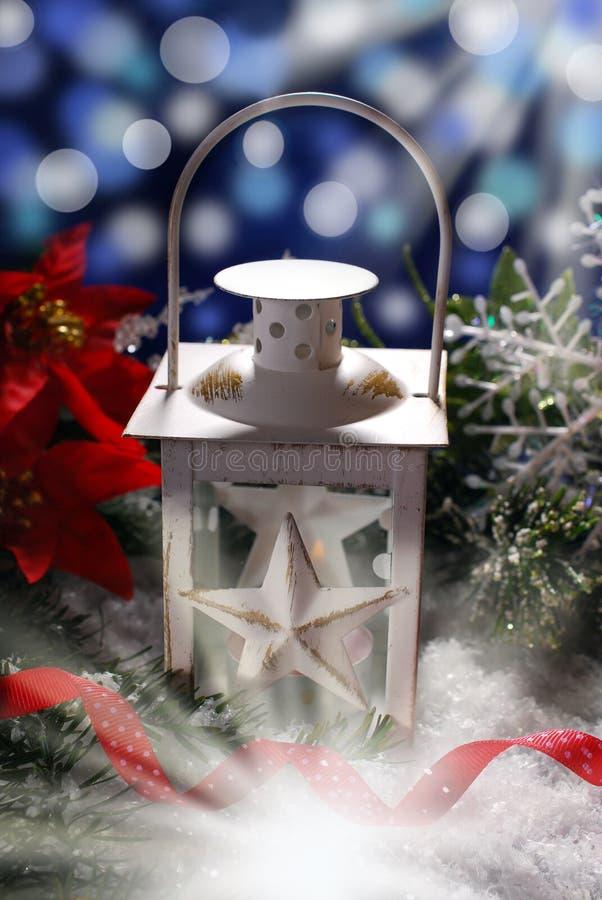 Christmas vintage lantern in dark night. Christmas decoration and burning vintage lantern in dark night royalty free stock photo