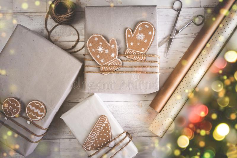 Christmas vintage presents on a wooden background. Christmas background with decorations and gift boxes on wooden board stock photos