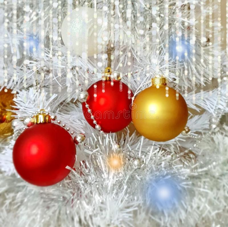 Christmas  wallpaper holiday white gold silver red green balls with snowflakes  light decoration light new year blurry lights back. Modern Christmas tree royalty free stock photo