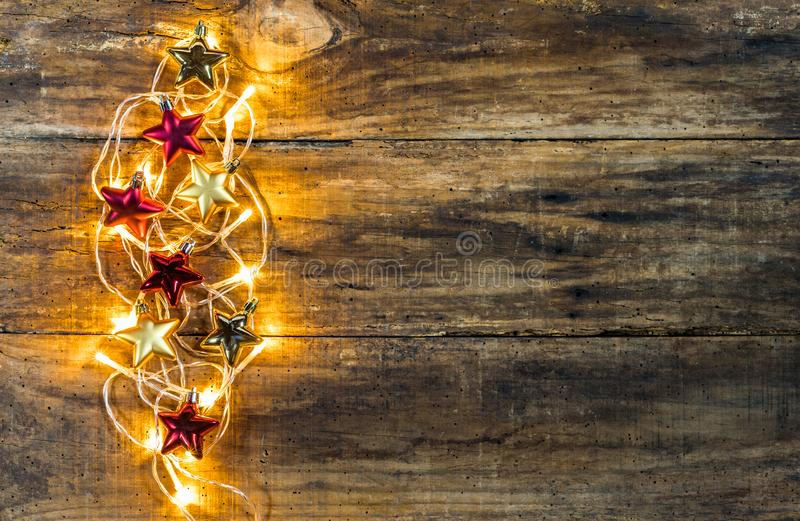 Golden Christmas lights and stars ornaments stock photo
