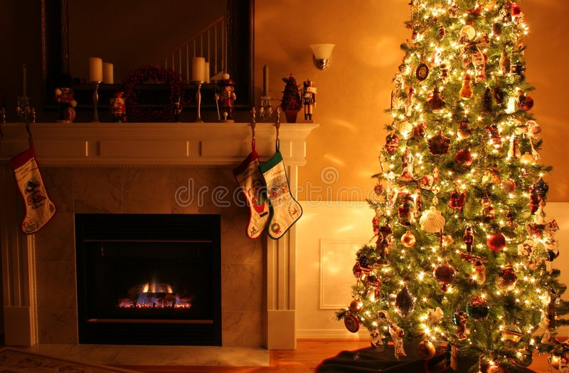 Christmas Warmth. An interior of a living room decorated for the holidays royalty free stock image