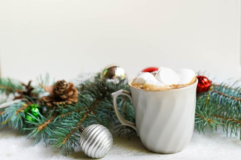 Christmas white background with coffee and decorative fir branches, new year card stock image
