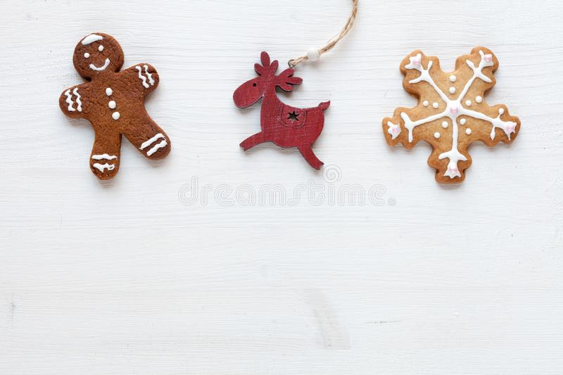 Christmas white background with gingerbreads and other christmas decor stock photography