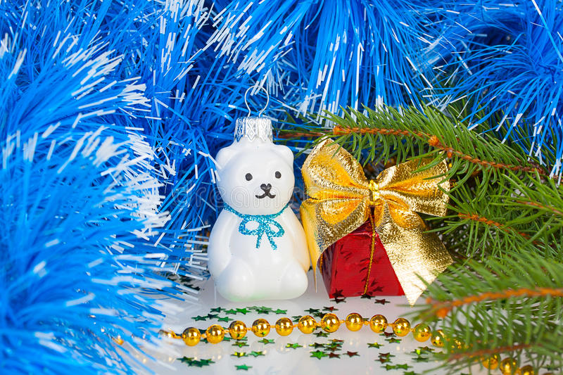 Christmas white teddy bear with decorations stock images