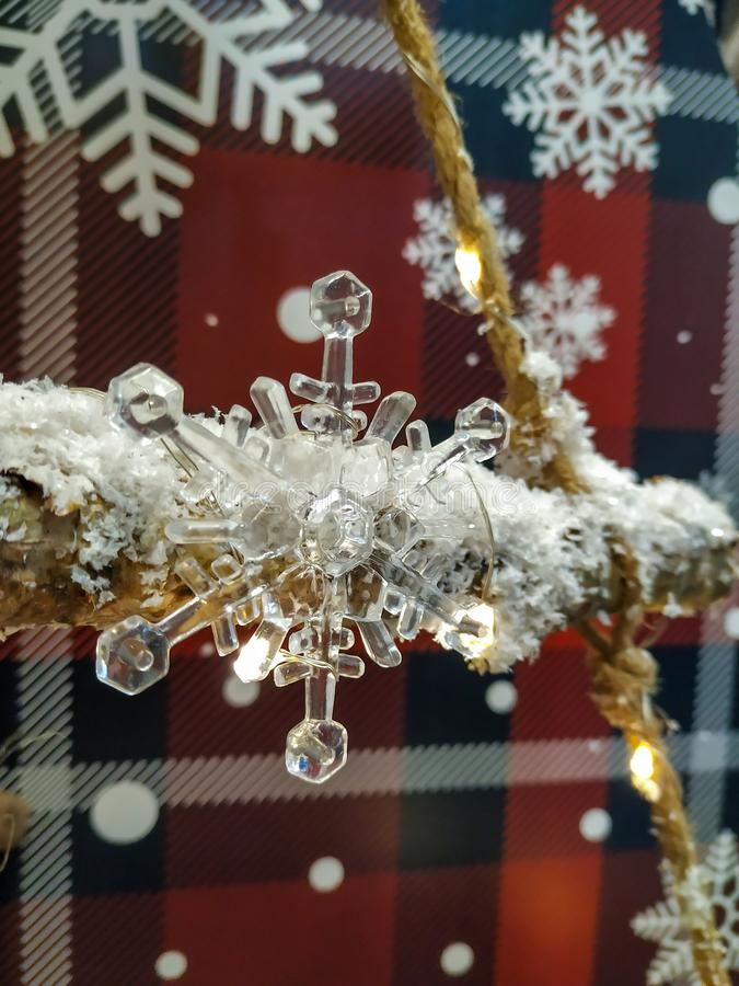 Christmas white transparent opacity snowflake with christmas themed red and blue background. Snow on the rope for holiday feeling stock photography