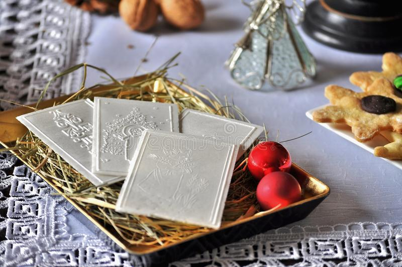 Christmas white wafer on table. Oplatek royalty free stock photos