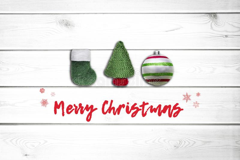 Christmas white wooden background with fir tree, green sock, and christmas ball. View with copy space. Concept holidays stock image