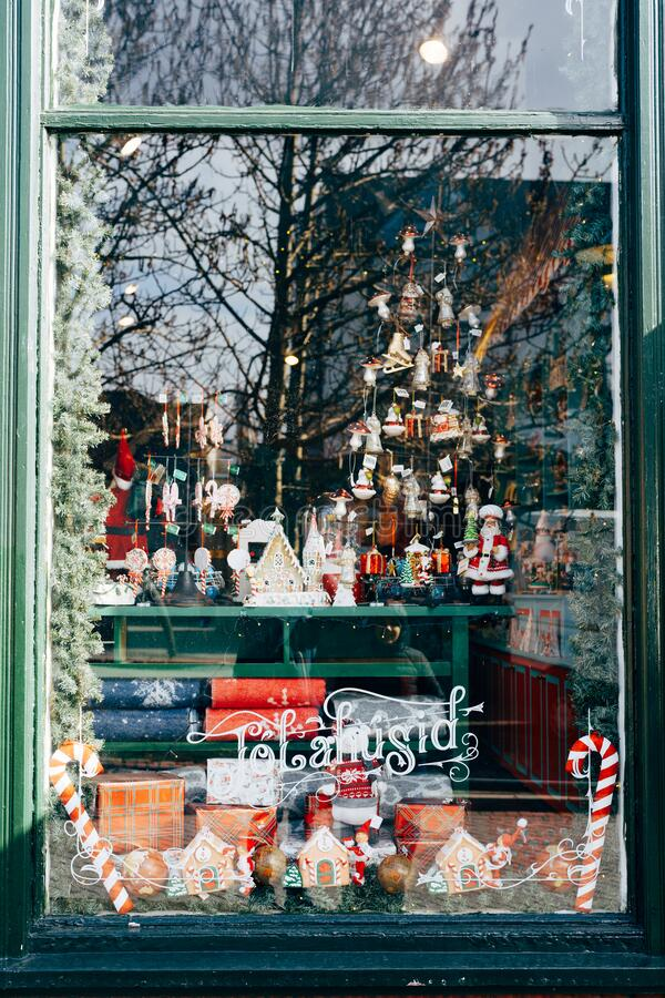 Free Christmas Window Decoration With Figurines And Toys With Street Reflection In Glass. Stock Images - 191622304
