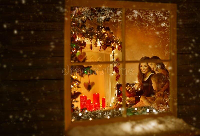Christmas Window, Family Celebrating Holiday, Winter Night House stock images