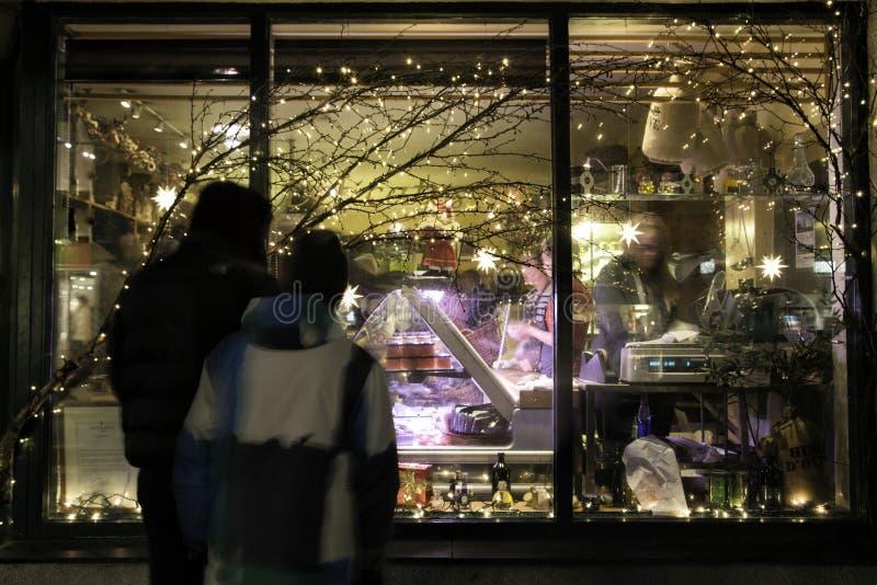Couple doing christmas window shopping royalty free stock photography