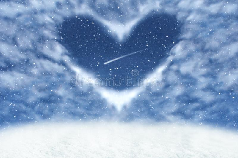 Christmas winter background with clouds in heart frame. Happy and love background. Christmas royalty free stock photo