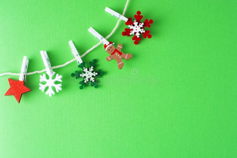 Christmas, winter background with copy space. Garland made of decorations snowflakes.Flat lay, top view. Flatlay, party, green, creative, design, frame, border royalty free stock photos