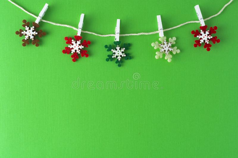 Christmas, winter background with copy space. Garland made of decorations snowflakes.Flat lay, top view. Flatlay, party, green, creative, design, frame, border royalty free stock photography