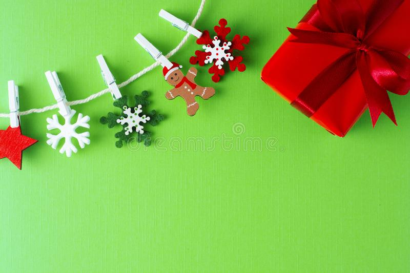 Christmas, winter background with copy space. Garland made of decorations snowflakes and red gift box. Flat lay, top view. Christmas, winter background with copy stock photos