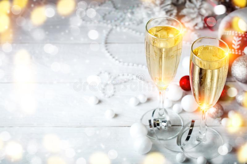 Christmas winter background. New Year`s toys. Happy New Year and Merry Christmas. Christmas winter background, New Year`s toys and champagne. Happy New Year and royalty free stock photo