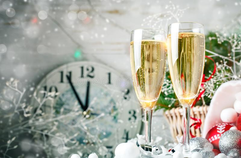 Christmas winter background. New Year`s toys. Happy New Year and Merry Christmas. Christmas winter background, New Year`s toys and champagne. Happy New Year and royalty free stock photography