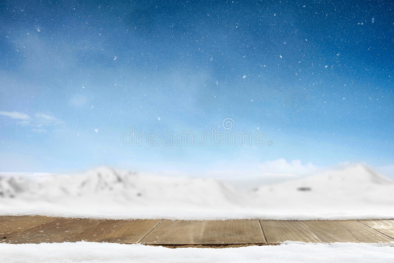 Christmas winter background and table of wood. Merry christmas g. Reeting card with copy-space royalty free stock image