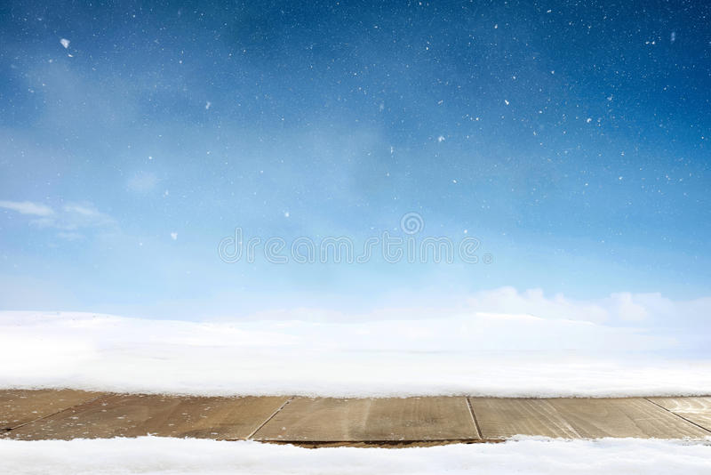 Christmas winter background and table of wood. Merry christmas greeting card with copy-space.. stock photography