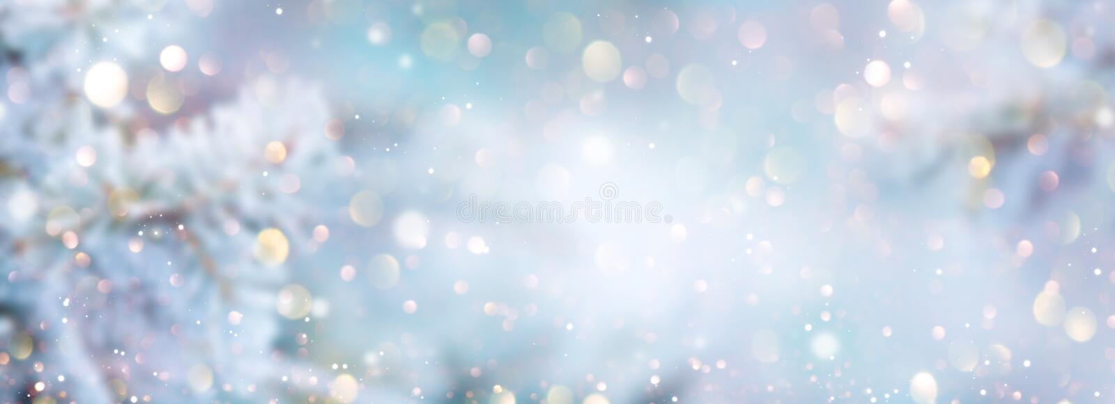 Christmas winter blurred background. Xmas tree with snow decorated with garland lights, holiday festive background. Widescreen backdrop. New year Winter art stock photos