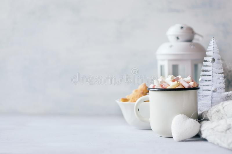 Christmas Winter cozy banner. Coffee with marshmallows, xmas cookies, knitted sweater, white heart and decorative Christmas royalty free stock images