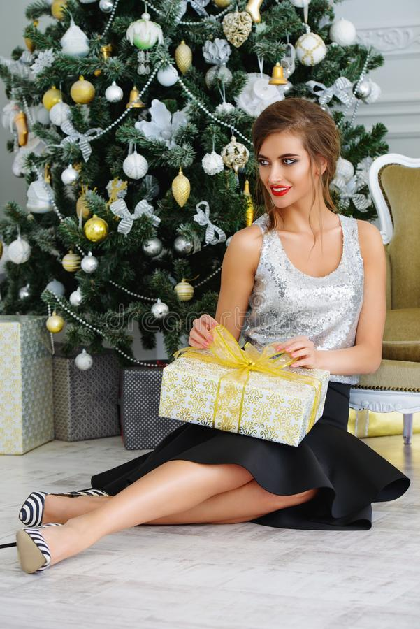 Attractive girl with gift royalty free stock photography